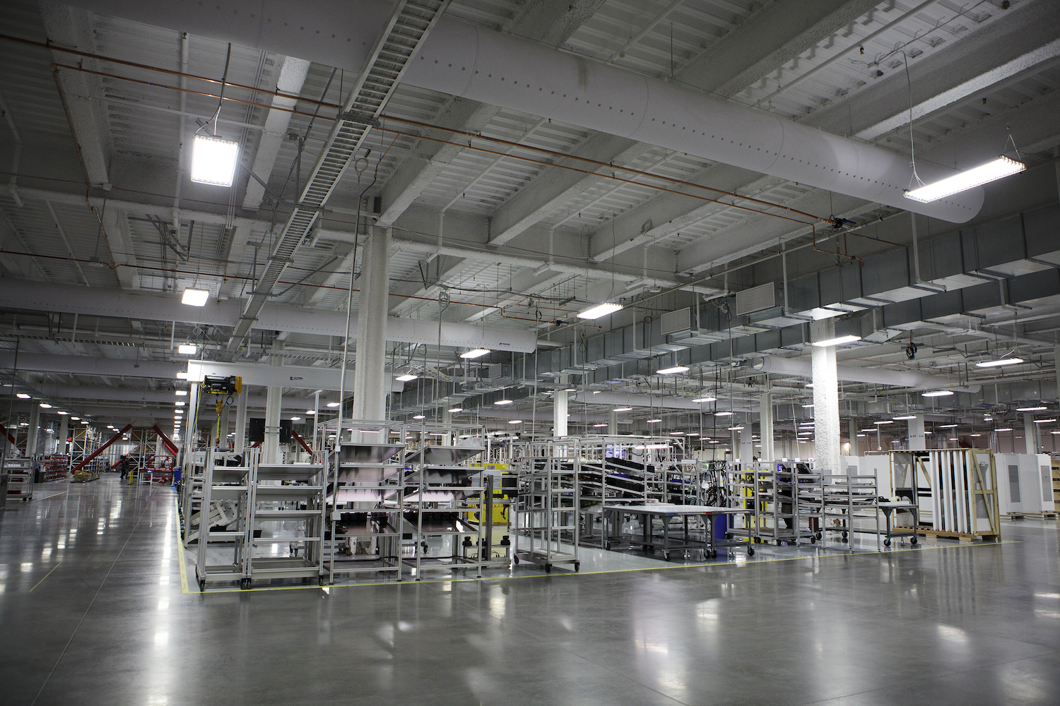 Machinery stands inside the Tesla Motors Inc. Gigafactory in Sparks, Nevada, U.S., on Tuesday, July 26, 2016. Tesla officially opened its Gigafactory on Tuesday, a little more than two years after construction began. The factory is about 14 percent complete but when it's finished, it will be about 10 million square feet, or about the size of 262 NFL football fields. Photographer: Troy Harvey/Bloomberg